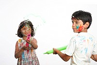Ten and eight year old boy and girl want to spray water colours on glass with help of big plastic syringe MR703U,703V