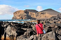 Woman looking at volcano Dos Capelinhos, Island of Faial, Azores, Portugal, Europe