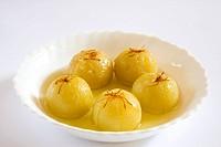 Fruits , gooseberry emblica sweet pickles kesar amla murabba emblica officinalis deep fry in sugar with saffron
