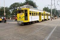 Yellow Tram On the Street of Kolkata , West Bengal , India