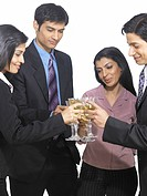 South Asian Indian executive men and women toasting wine glass MR