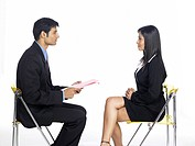 South Asian Indian executive man taking interview of woman MR