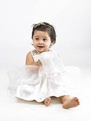 Joyful Indian baby girl wearing white dress MR702O