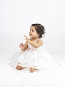 Joyful Indian baby girl wearing white dress MR702O