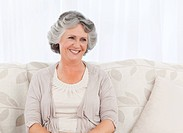 Smiling retired woman at home