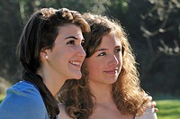 Two teenage girls looking ahead