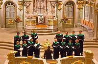 A choir performs a concert inside the Frauenkirche church, Dresden, Saxony, Germany