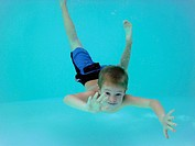 Boy, 6 years old, underwater in a pool