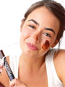 Brunette woman with a chocolate mask
