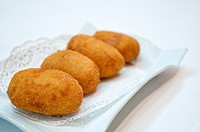 Spanish tapa: croquettes serving. Close view.