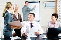 Portrait of several businesspeople interacting during business seminar