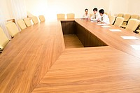 Photo of business people sitting at table in the boardroom and working together