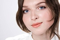Close_up of pretty blue_eyed females face expressing positive mood