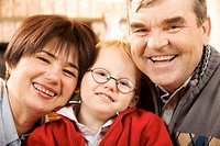 Portrait of happy grandparents and their grandson smiling at camera