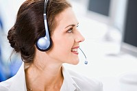 Beautiful business womant is smiling and looking away in an office environment