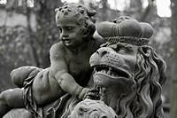 Sculpture of a child and a lion king in the park of the Residenz palace in Wuerzburg, Bavaria, Germany