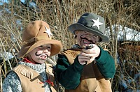 Boys, 5 and 7, dressed as cowboys for Carnival