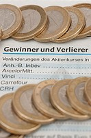 Coins on the stock exchange section of a newspaper, stock market
