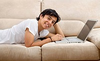 Casual man working on a computer from home