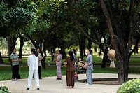 Vietnamese women doing Tai Chi together on a Saturday afternoon, weekend leisure activity in Lenin Park near the Technical University of Hanoi, Vietna...