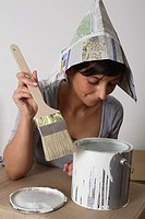 Young Woman with Paper Cap, Brush and Paint Pot