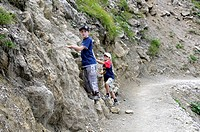 First attempt at climbing, two children, seven and eight years old, during a walk, Allgaeu Alps, Bavaria, Germany, Europe