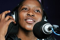 Teenager on the air in their own radio station, HIV AIDS Awareness, loveLife Youth Centre, slum, Orangefarm Township, Johannesburg, South Africa, Afri...