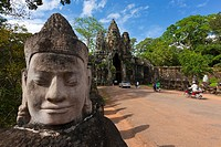 Stone sculptures border the bridge to the temple Angkor Thom in Angkor  Cambodia  Asia