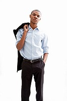 Young African business man standing relaxed and secure with hand in pocket and jacket over shoulder, isolated