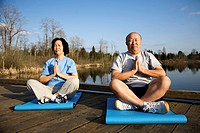 A shot of a senior asian couple meditating and practicing yoga