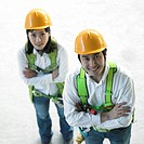 at a construction place, architects folding their arms