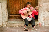 A physically-challenged musician entertains and inspires passersby on a street in Centro Guanajuato, Mexico