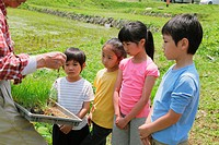 Children Looking Plant Seed On a Farm