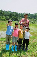 Kids And Aged Man Holding Plant Seed