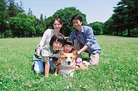 Family Enjoying In a Park With Dog