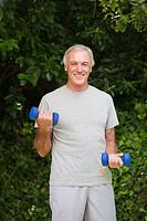 Senior man doing his exercises in the garden