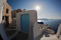 Greece, Cyclades, Thira, Santorini, View of stairs with blue door and aegean sea