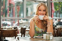 Germany, Munich, Teenage girl in cafe, smiling, portrait