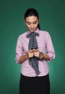 Close_up of a businesswoman text messaging on a mobile phone