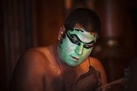 Man applying make_up for Kathakali performance, Kochi, Kerala, India