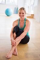 Portrait of woman sitting in gym
