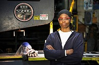 Black worker standing in factory