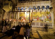 Christians praying,  Stone of Unction, Church of the Holy Sepulchre, Old City, UNESCO World Heritage Site, Jerusalem, Israel.