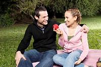 Couple enjoying picnic in a park
