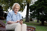 Woman using a mobile phone in a park