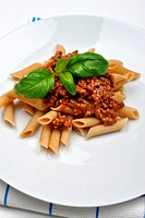 home made pasta with mince sauce and basil