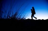 Man hikes with a crash pad.