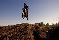 Catching air on a motocross bike.