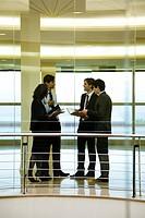 Group of executives talking in corridor