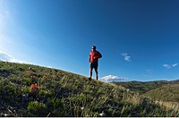 A young man runs on a trail through Wyoming.